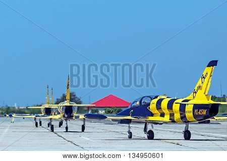 TIMISOARA ROMANIA - MAY 21 2016: Fighter jets lineup takeoff in a local air show. Baltic Bees team.
