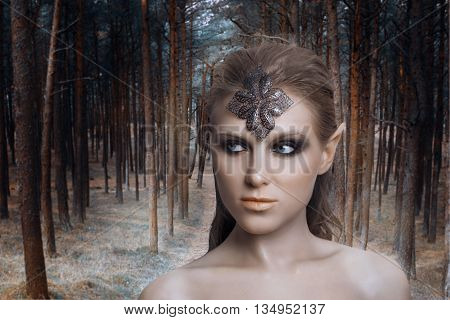 beautiful elf woman in a magical forest