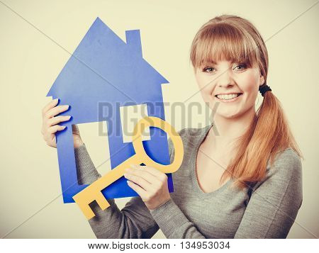 Young Blonde Lady Holding Symbols.