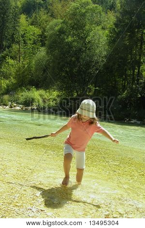 Child playing in river