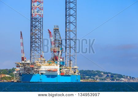 Jack up oil drilling rig in the shipyard for maintenance in Dundee Scotland UK