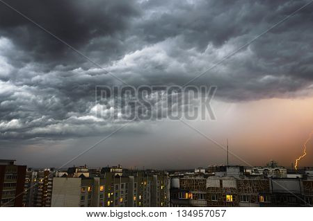 Storm Clouds, Heavy Rain. Thunderstorm And Lightning Over The City.