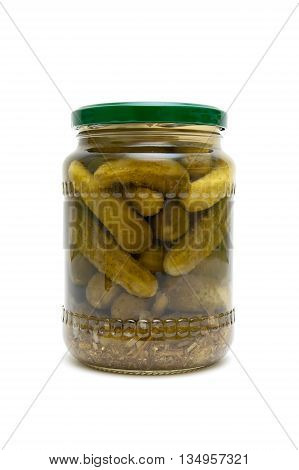 pickled cucumbers in a glass jar on a white background. vertical photo.