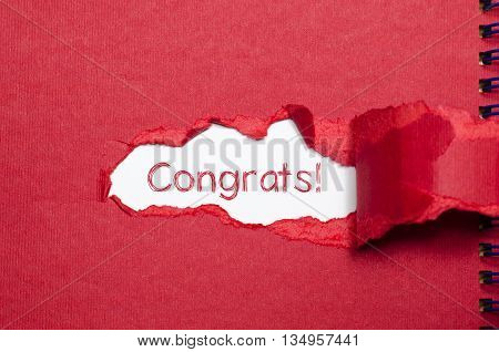 The word congrats appearing behind torn paper.