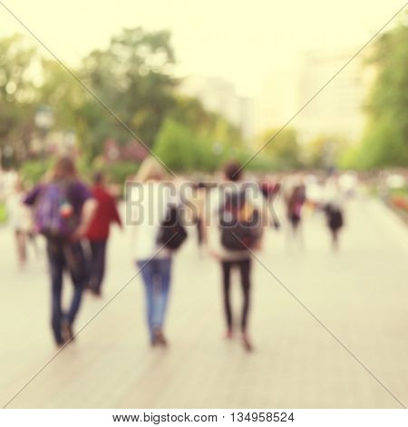 Blurred image of people walking in the city.