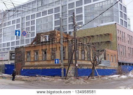 Nizhny Novgorod Russia. - February 12.2016. Demolition of an old house on a background of new buildings in Nizhny Novgorod. Russia.