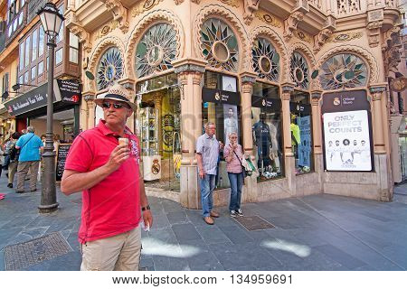 Icecream Man In Front Of Can Corbella Art Nouveau Building