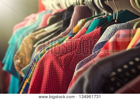 Clothes Hanging On The Rack In The Store