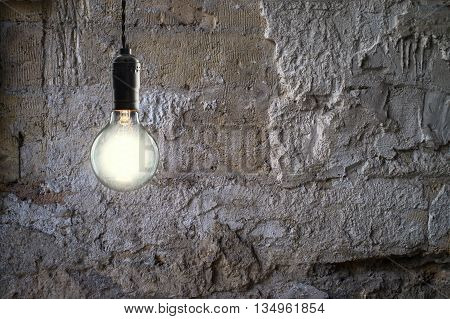 Idea and leadership concept Vintage bulbs on wall background copy space for text