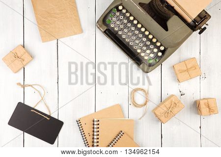 Vintage Typewriter, Notepads, Present Boxes On The White Wooden Background