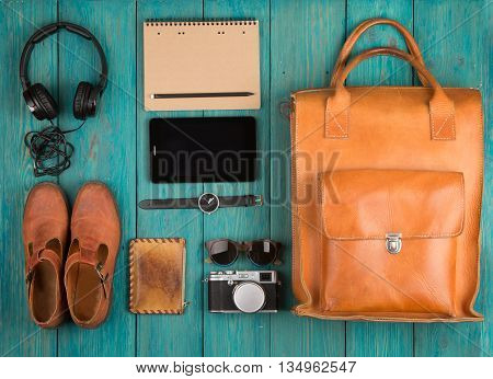 Tablet Pc, Clothes, Headphones, Camera, Shoes, Watch And Sunglasses On The Desk