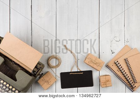 Vintage Typewriter, Notepads, Present Boxes And Mini Blackboard On The White Wooden Background