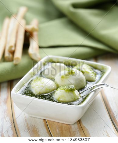 Italian antipasti mozzarella cheese with green pesto