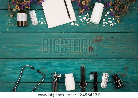 Workplace Of Doctor - Stethoscope, Medicine Clipboard, Bottle, Flower, Glasses, Watch And Pils