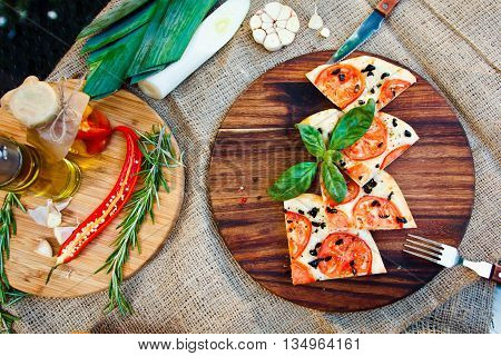 Fresh Hot Pizza With Parmesan Cheese, Basil And Tomatoes