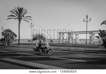 France, Nice, Cote d'Azur - A motorbike caught on the road