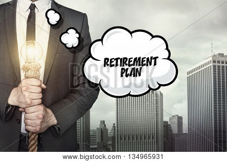 Text on speech bubble with businessman holding lamp on city background