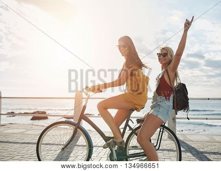 Happy Young Women Enjoying Bike Ride
