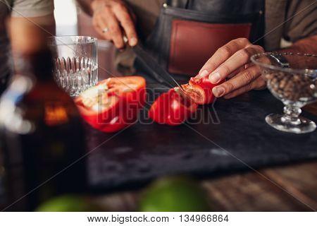 Bartender Hands Chopping Red Bell Pepper