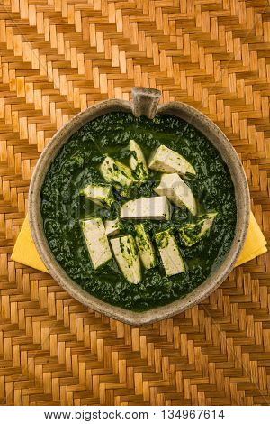 palak paneer served with naan / roti / paratha / chapati / phulka or fulka / indian bread, isolated on white background