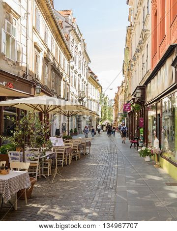 LJUBLJANA SLOVENIA - 26TH MAY 2016: A view along streets of Ljubljana during the day. Buildings shops and restaurants can be seen.