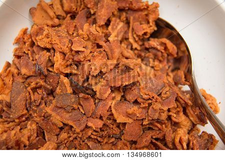 closeup Crispy bacon in white bolwe background