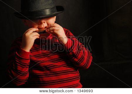 Boy With Harmonica