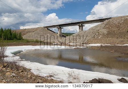 Railway bridge on the mound in South Yakutia Russia