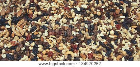Background from mixture close up dried raisins fruits and nuts