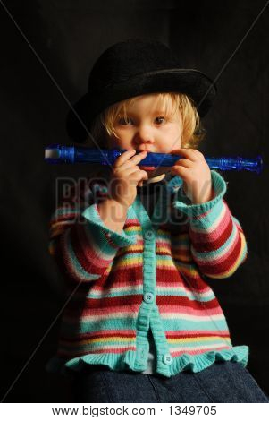 Toddler With A Blue Flute