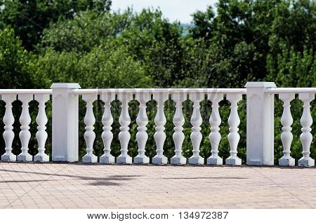 Stone decorative railings in the old Park