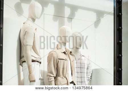 Mens clothing in a retail store in shop window