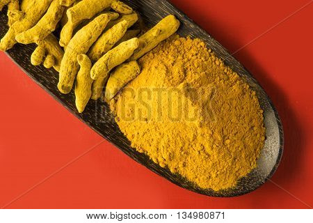 dry Turmeric and turmeric powder, top view