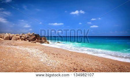 Beautiful beach landscape, panoramic scene of the calm coast at summer time, Mediterranean sea