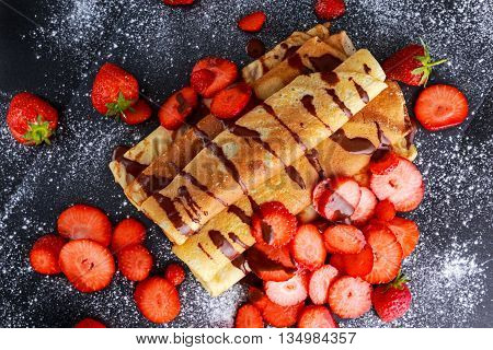 Sweet Rolled Pancakes with nutella and strawberry.