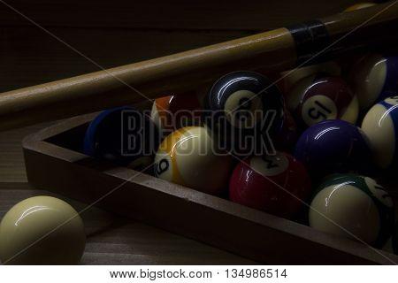 portrait of set of biliard balls illuminated with light paint technique