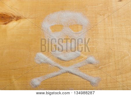 Sugar skull on wooden background. Unhealthy life concept