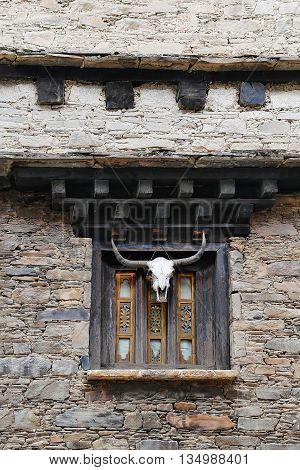 Traditional Tibetan house style - window with yak skull