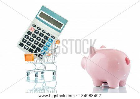 Piggy Bank, Calculator And A Shopping Trolley