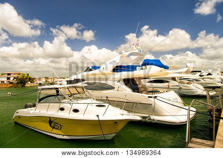 Yachts In Bay With Cloudy Sky