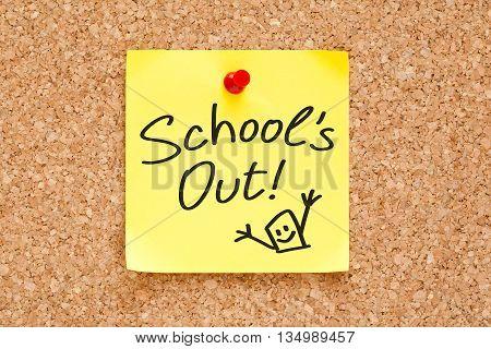 School is Out handwritten on a sticky note pinned on cork bulletin board.