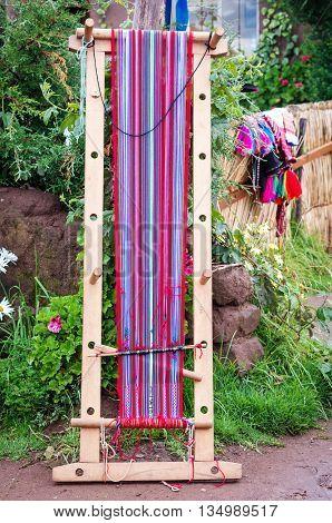 Peruvian weaving at lake Titicaca on Taquile Island in Peru