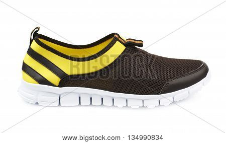 Light running sport shoes, colored yellow and black, isolated over the white background