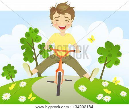 Cheerful Boy riding bike on a summer day