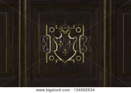 FONTAINBLEAU, FRANCE - MAY 16, 2015: This is Royal coat of arms of France on the wood sheathing panels of the ballroom.