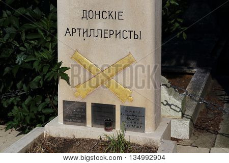 SAINT-GENEVIEVE-DE-BOIS, FRANCE - MAY 16, 2015: Cemetery St. Genevieve de Bois is the burial place of Russian immigrants.This is a common grave of soldiers of the White Army.