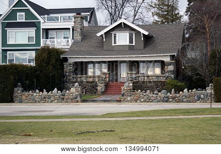 HARBOR SPRINGS, MICHIGAN / UNITED STATES - DECEMBER 24, 2015: An elegant house made of stone and brick, across from the Zorn Park Beach in Harbor Springs.