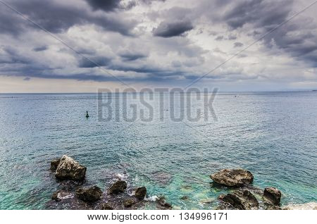 France, Nice, Cote d'Azur - Cloudy sky on the coast in November