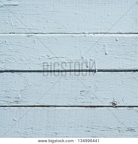 Close-up fragment of a wall made of old painted wooden planks as a background texture composition