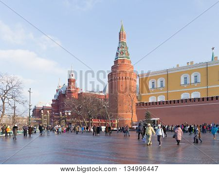 Moscow - January 7 2016: A lot of people walk around the Kremlin walls in the Alexander Garden winter and the entrance to the Alexander Garden January 7 2016 Moscow Russia